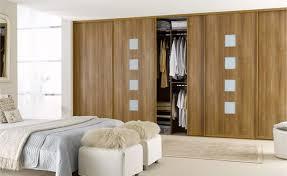 elegant wooden wardrobe designer for master bedroom design ideas with sliding doors