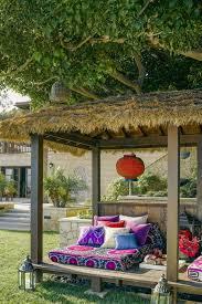 Stunning garden pergola ideas roof Arched Outdoor Lighting Lighting Elle Decor 36 Gorgeous Outdoor Rooms Outdoor Room Decor Ideas