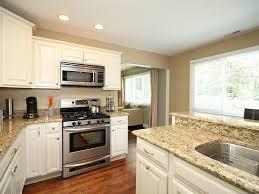 white shaker cabinets dark floors. beautiful kitchen...love the white cabinets, dark hardwood floors, pretty granite shaker cabinets floors p