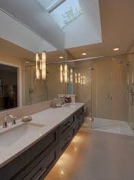 overhead vanity lighting. simple lighting contemporary bathroom idea in vancouver with solid surface countertops and  an undermount sink intended overhead vanity lighting