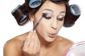 makeup mistakes to avoid woman with curlers apply eye shadow