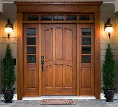 potted cone shaped pine trees standing symmetrically for a simple yet brilliant looking front door