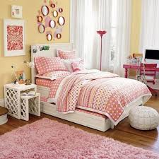 contemporary teenage girl bedroom decoration using light yellow girl room wall paint including round pink mirror bedroom wall decor and furry light pink rug