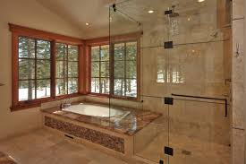 this similar setup by ward young architecture and planning has a fully enclosed steam shower that enjoys the same views as the soaking tub