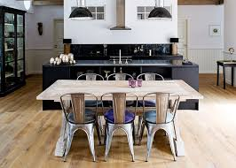 these xavier pauchard chairs and the industrial looking lamps gives this kitchen both some character and some edge plb chairs xavier pauchard