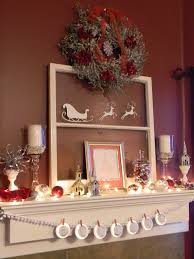 interior white mantel decorating ideas showing silver wreath with red ribbon on the wall