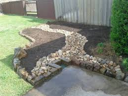 ideas using river rock | flower-bed-with-moss-rock-and