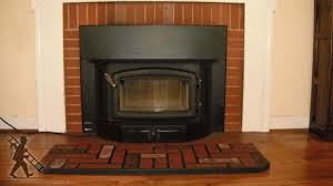 renovating a fireplace by installing a wood stove insert if