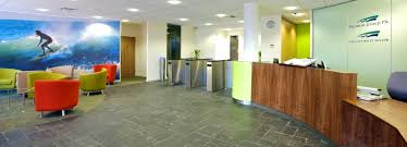 Grey Tiled Floor With Wooden Reception Desk For Large Office Reception Area  Design Ideas
