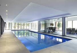 indoor swimming pool lighting. Impressive Indoor Swimming Pool With Glass Door And White Ceiling Lighting Idea