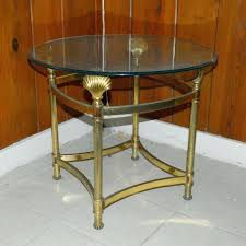 small round glass top side table brass seashell