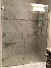 frameless inline glass shower door secured with u channel brushed nickel hardware