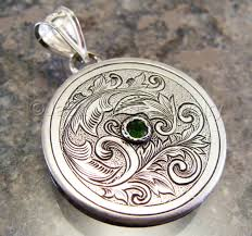 hand engraved art nouveau silver scrollwork with russian chrome diopside pendant