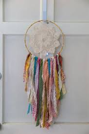 Find a place to hang your dream catcher for this next step. I use a wreath  hanger on my front door.