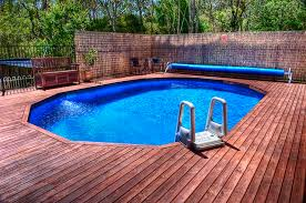 in ground swimming pool. Affordable Pool - Semi In-ground Decked In Ground Swimming