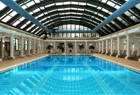 indoor swimming pool lighting. classy hotel indoor swimming pool design with lengthwise classic fountains decor and antique pendant lights also perfect porch chairs foru2026 lighting n