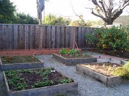 raised garden beds help retain water better than gardens planted in open soil