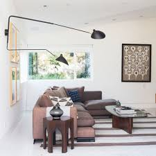 serge mouille lighting. unique lighting example of a trendy living room design in los angeles with white walls inside serge mouille lighting