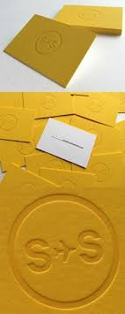 embossed logo on a bright yellow business card for a social a agency