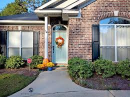 brick exterior with black shutters greige trim and benjamin moore wythe blue front door