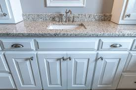 White bathroom cabinets with granite Dallas White Bathroom Vanity Topped With Verona Granite And White Shaker Style Cabinets For The Base East Coast Granite Tile Bathroom Granite Image Galleries For Inspiration