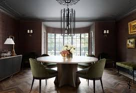 country club tudor dining room wood herringbone floors and grcloth walls interior design by