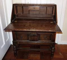 dark oak writing desk bureau with two drawers and fold down writing surface