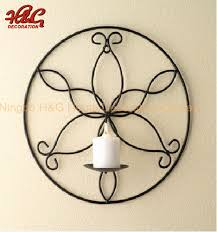 round metal wall hanging candle holder
