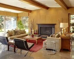 dark brown fireplace mantel with black framed wall fireplace on a living room with mid