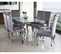 louis white glass dining table with six silver velvet chairs