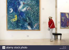 visitor or tourist admiring chagall painting in the marc chagall museum and art gallery cimiez nice alpes maritimes france