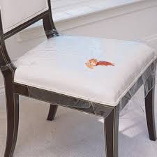 use plastic seat covers to protect your dining room chairs from spills and drips ideal to use with kids or s these plastic seat protectors tie to