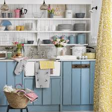 country kitchen with blue painted cabinets and open shelving