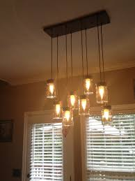 amazing crowded alen and roth pendant lighting idea with wooden track and transpa shades on ceiling