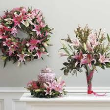 asiatic lily urn arrangement wreath and vase arrangement