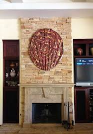 copper wall art over fireplace