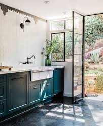 image above these stunning black metal doors and window frames in candis cayne s la home are exactly what i hope we can install in our home in some way