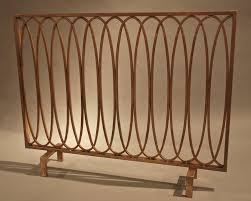 antique gold oval loop iron fireplace screen