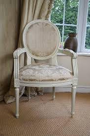 a french style chair painted in cream with champagne coloured fabric perfect for