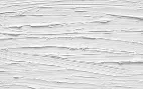 a close up of a texture on a white wall