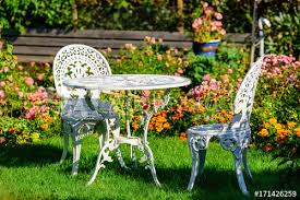 white metal outdoor furniture group in