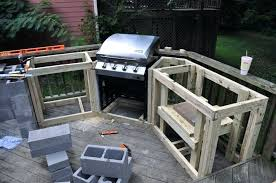 imposing outdoor kitchen cabinet frames from plywood material with built in steel grill also combine concrete