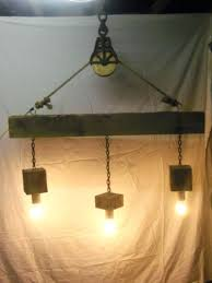 wood beam chandelier reclaimed barn and pulley simple light