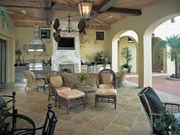 family room design with granite floor kitchen chairs coffee table and flat screened tv on the