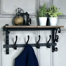 ornate wooden wall shelf with coat hooks storage baskets white cubby hook and unit above
