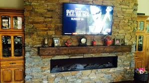 stone fireplace electric electric fireplace mounted on wall stone surround wood mantle castlecreek electric stone fireplace