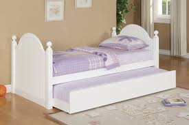 white wooden bed frame with trundle and headboard complete with blue bedding set