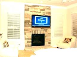 mount tv above fireplace no studs hnging ides mounting over without
