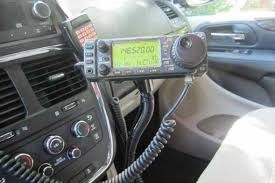 my mobile installation this photo shows the 220 radio and the switch box in front of the cup holders and the cb radio at the back the cb is a temporary install for long trips