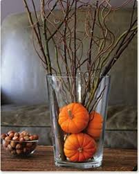 simply put several very small pumpkins in a vase and add some twigs your got
